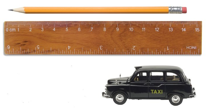 measuring length - ruler with pencil and toy taxi